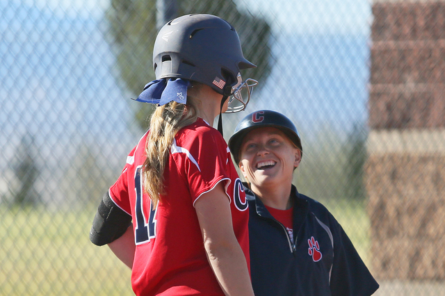 Coronado head coach Melissa Krueger, right, laughs while speaking with pitcher Sarah Pinkston during a softball game against Rancho at Coronado High School Wednesday, April 8, 2015, in Henderson.  ...