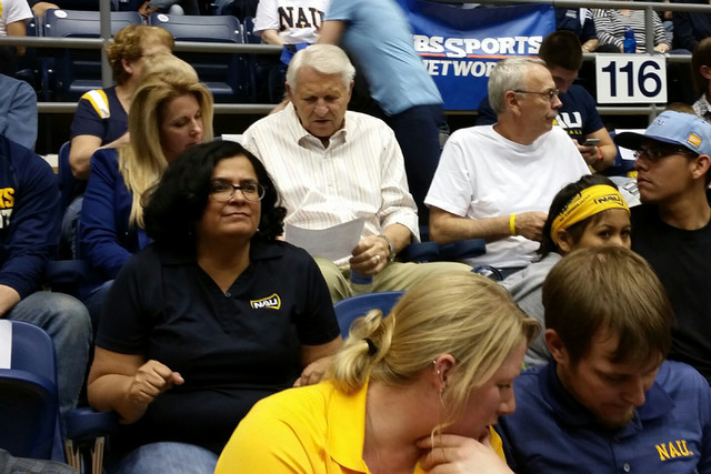 Arizona coaching legend Lute Olson, in striped shirt, checks the stat sheet with his wife, Kelly, at the Walkup Skydome in Flagstaff, Ariz., on March 31, 2015. Olson came to support Northern Arizo ...