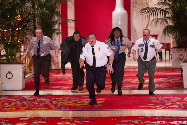 Paul Blart (Kevin James) with Gino Chizetti (Vic DiBitetto) , Khan Mubi (Shelly Desai), Donna Ericone (Loni Love) and Saul Gundermutt (Gary Valentine) take on the art thieves in the grand hallway  ...