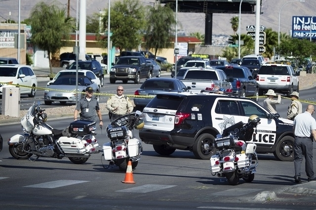 Las Vegas police officers investigate an accident where Maria Garcia and Alyssa Aisa were hit and killed by a vehicle on Monday, March 30,2015. (Jeff Scheid/Las Vegas Review-Journal) Follow Jeff S ...
