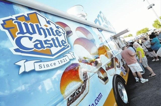 """Customers line up at the White Castle """"Crave Mobile"""" during the Las Vegas Foodie Fest in the parking lot of the Silverton on Saturday, Oct. 19, 2013. (Bill Hughes/Las Vegas Review-Journal)"""