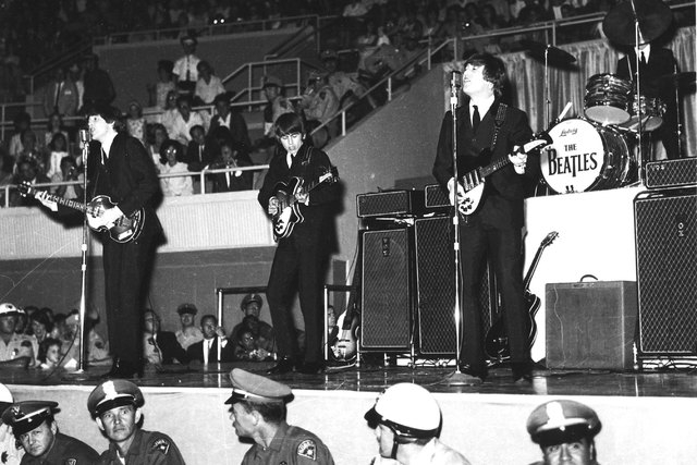The Beatles, from left, Paul McCartney, George Harrison, John Lennon and Ringo Starr, play the Convention Center on Aug. 20, 1964. (Review-Journal archive)