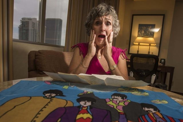 Christie Mullikin Jones re-enacts her experience of seeing the Beatles in concert 50 years ago at the Las Vegas Convention Center. She is photographed at her room at Westgate Las Vegas Resort on F ...