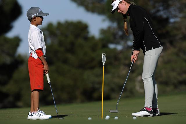 Local junior golfers Avery Lazarski, left, and Morgan Goldstein practice putting at TPC Summerlin in Las Vegas Thursday April 02, 2015.(Josh Holmberg/Las Vegas Review Journal)