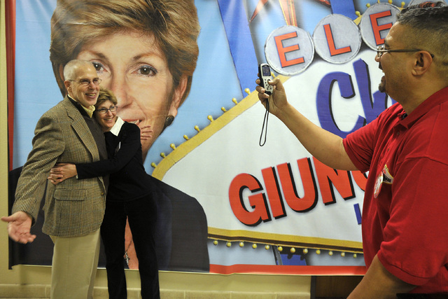 Las Vegas mayoral candidate Chris Giunchigliani and her husband Gary Gray, left, pose as Derek Washington, constituency outreach liaison for the campaign, takes a photo at Giunchigliani's campaign ...