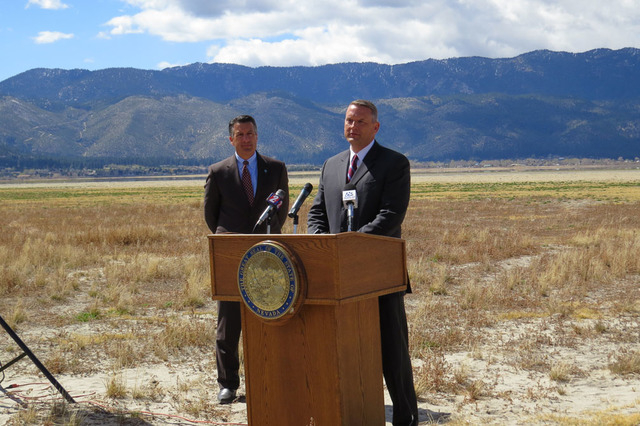 Gov. Brian Sandoval, left, and John Enstminger, general manager of Southern Nevada Water Authority, speak at a news conference Wednesday, April 8, 2015, at Washoe Lake State Park. Sandoval signed  ...