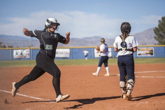 Palo Verde High School's Grace Chavez (25) scores against Centennial High School during their softball game played at Centennial's softball field in Las Vegas on Friday, April 17, 2015. (Martin S. ...