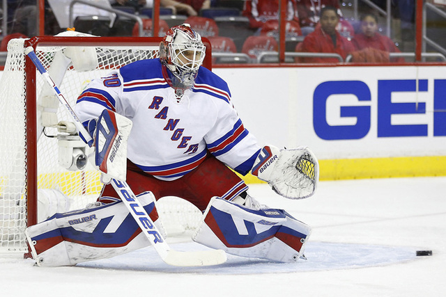 Apr 11, 2015; Washington, DC, USA; New York Rangers goalie Henrik Lundqvist (30) make a save against the Washington Capitals in the first period at Verizon Center. The Rangers won 4-2. (Geoff Burk ...
