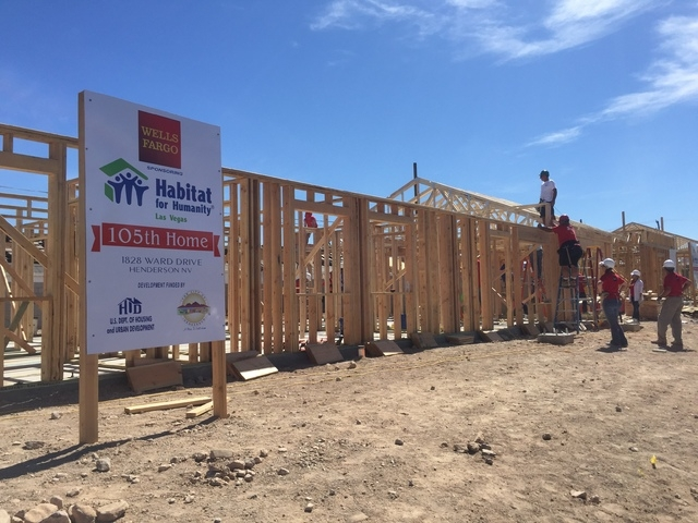 Habitat for Humanity Las Vegas raised the walls on a Henderson home March 14, 2015, with the help of Wells Fargo Bank volunteers. The nonprofit provides homes for low-income families and works to  ...