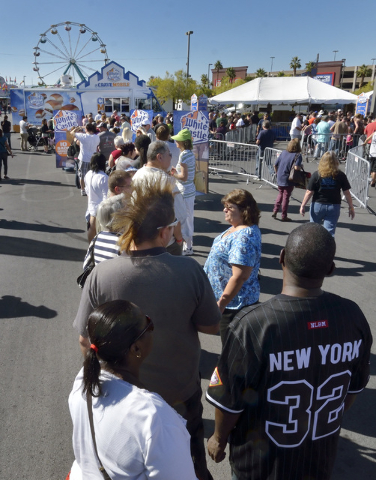 "A long line forms in front of the White Castle ""Crave Mobile"" during the Las Vegas Foodie Fest in the parking lot of the Silverton hotel-casino at 3333 Blue Diamond Road in Las Vegas on  ..."
