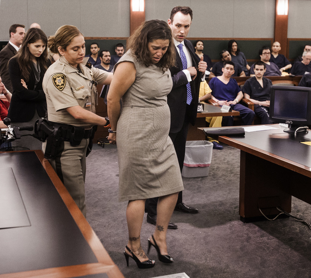 Patience Bristol is led away during her sentencing at Regional Justice Center on Wednesday, May 28, 2014. Bristol pleaded guilty tp exploitation of an elderly/vulnerable person and will serve thre ...