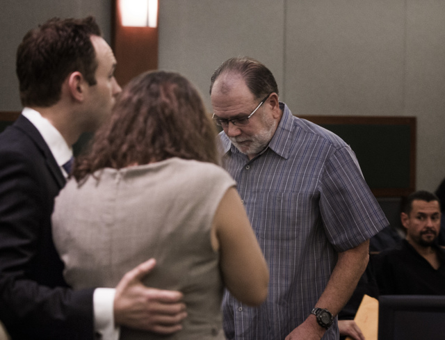 Dr. Ron Dutton, right, walks past Patience Bristol, center, after he made a victim impact statement during her sentencing at Regional Justice Center on Wednesday, May 28, 2014. Bristol is comforte ...