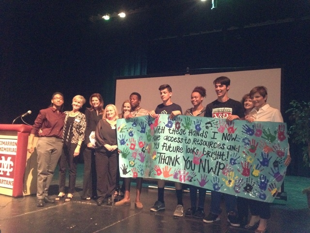Students celebrate news of a grant March 24, 2015, at Cimarron-Memorial High School, 2301 N. Tenaya Way. The grant was through Communities In Schools of Nevada, which was named the recipient of th ...
