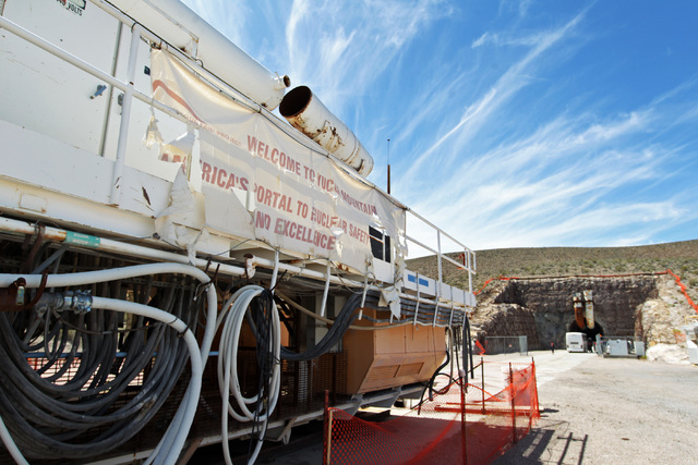 "A tattered sign proclaiming Yucca Mountain as ""America's Portal to Nuclear Safety and Excellence"" is seen outside the south portal during a congressional tour of the Yucca Mountain explo ..."