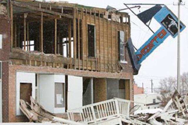 Historic buildings on Front Street in Wells, Nev., show heavy damage Feb. 21, 2008, after an ea ...