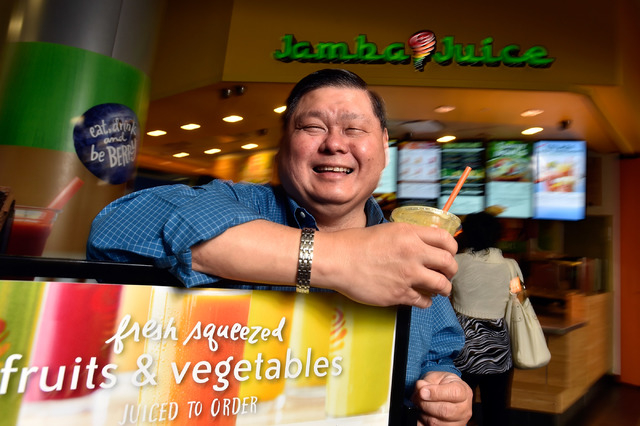 """Michael Ty appears in front of his Jamba Juice location at the """"C"""" gates at McCarran International Airport on Friday, May 8, 2015, in Las Vegas."""