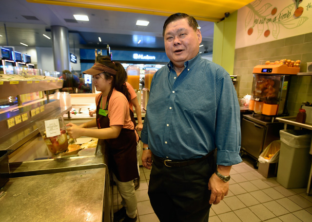 """Michael Ty appears behind the counter of his Jamba Juice location at the """"C"""" gates at McCarran International Airport on Friday, May 8, 2015, in Las Vegas."""