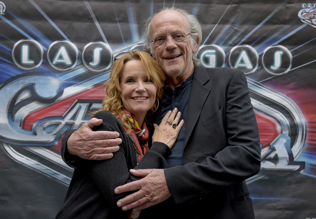 """Actors Lea Thompson, left, and Christopher Lloyd wait to go onstage at the Fremont Street Experience in Las Vegas with other """"Back To The Future"""" cast members to celebrate the 30th anniv ..."""