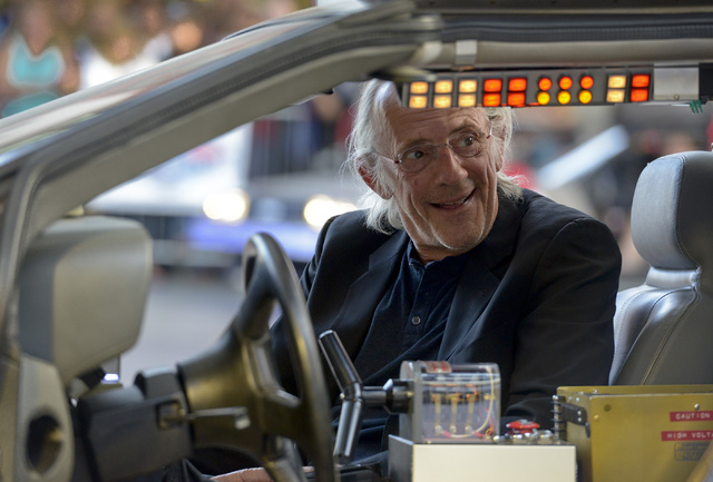 """Actor Christopher Lloyd arrives at the Fremont Street Experience in Las Vegas in a """"Back to the Future"""" custom Delorean as he and other cast members of the movie celebrate the 30th anniv ..."""