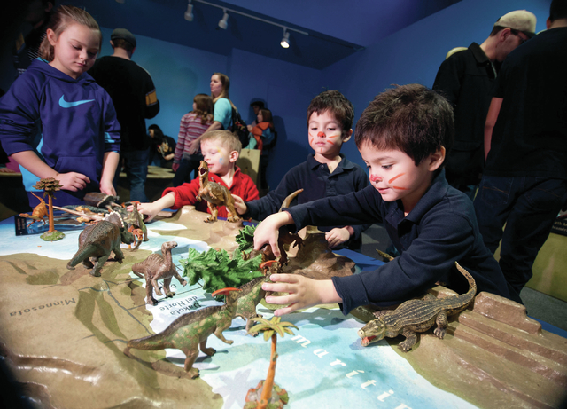 "Sculptured play tables in ""Dinosaurs: Land of Fire and Ice"" help visitors explore North American more than 100 million years ago, when dinosaurs lived near a shallow lake that dominated what's now ..."