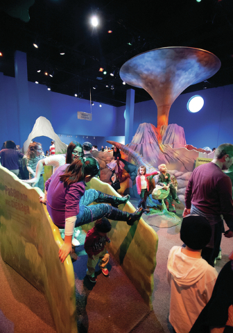 "Kids of all ages explore ""Dinosaurs: Land of Fire and Ice,"" which opens Saturday at the Discovery Children's Museum. (Courtesy.)"