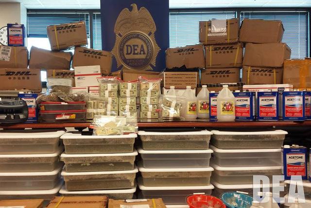 """Large amounts of money and designer synthetic drugs seized in Gulfport, Mississippi."" Courtesy (Drug Enforcement Administration/Facebook)"