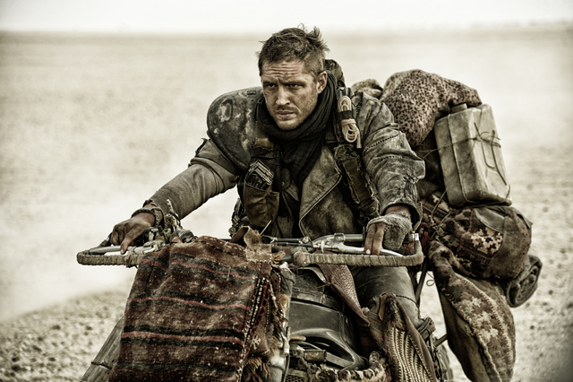"""This photo released by Warner Bros. Pictures shows Tom Hardy as Max in a scene from the film, """"Mad Max: Fury Road."""" (Courtesy, Warner Bros.)"""
