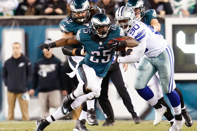 Dec 14, 2014; Philadelphia, PA, USA; Philadelphia Eagles running back LeSean McCoy (25) rushes past Dallas Cowboys defensive end Demarcus Lawrence (90) during the second half at Lincoln Financial  ...
