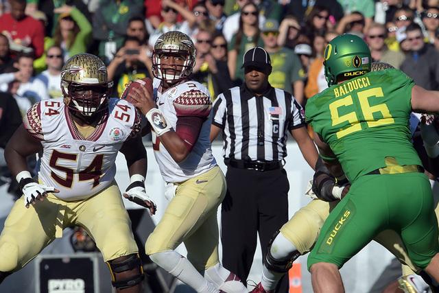 Jan 1, 2015; Pasadena, CA, USA; Florida State Seminoles quarterback Jameis Winston (5) drops back to pass against the Oregon Ducks in the 2015 Rose Bowl college football game at Rose Bowl. (Kelvin ...