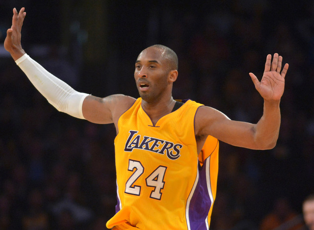 Jan 13, 2015; Los Angeles, CA, USA; Los Angeles Lakers guard Kobe Bryant (24) reacts against the Miami Heat at Staples Center. The Heat defeated the Lakers 78-75. (Kirby Lee-USA TODAY Sports)