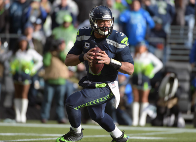 Jan 18, 2015; Seattle, WA, USA; Seattle Seahawks quarterback Russell Wilson (3) looks downfield to throw during the second quarter against the Green Bay Packers in the NFC Championship Game at Cen ...