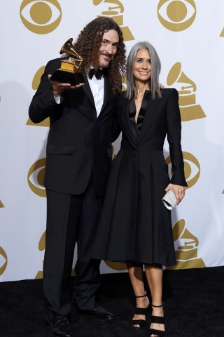 Singer 'Weird Al' Yankovic and Suzanne Krajewski pose in the press room with the award for Best Comedy Album for 'Mandatory Fun' during the pre-telecast at the 57th annual Grammy Awards in Los Ang ...