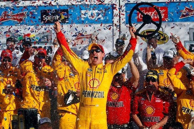 Feb 22, 2015; Daytona Beach, FL, USA; NASCAR Sprint Cup Series driver Joey Logano (22) celebrates winning the Daytona 500 at Daytona International Speedway. (Peter Casey/USA TODAY Sports)