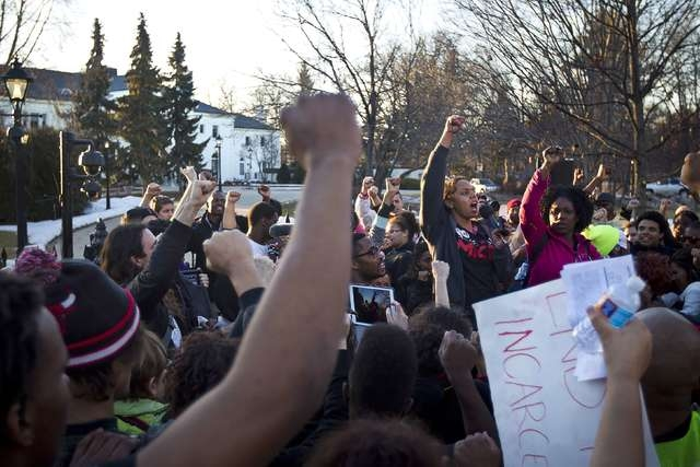 Hundreds of protestors gather outside the Governor's Mansion demanding justice for the shooting death of Tony Robinson, Jr.in Madison, Wisconsin March 11, 2015. (Ben Brewer/Reuters)