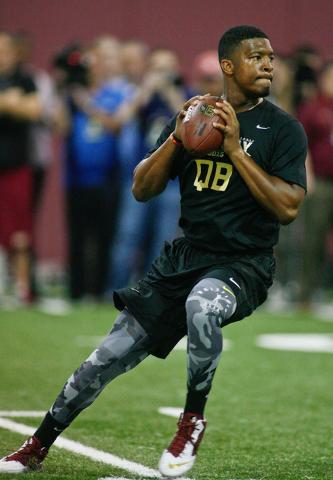 Mar 31, 2015; Tallahassee, FL, USA; Florida State Seminoles quarterback Jameis Winston passes during FSU Football Pro Day at the Albert J. Dunlap Athletic Training Facility. Mandatory Credit: Phil ...