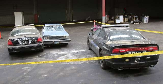 A view of the mockup of a crime scene showing the car positions during the manslaughter trial for a police officer in Cleveland, Ohio April 10, 2015. Michael Brelo, 31, is accused of shooting dead ...