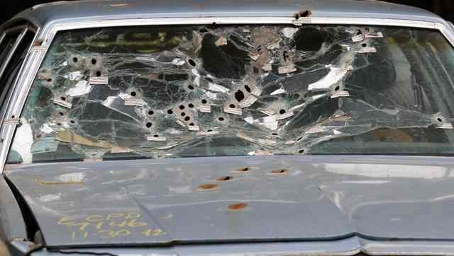 The windshield of Timmothy Russell's car is shown as the crime scene was mocked up for the court to review during the manslaughter trial for a police officer in Cleveland, Ohio April 10, 2015. Mic ...