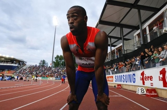 Tyson Gay of the U.S. reacts after winning in the 100m event of the Lausanne Diamond League meeting in Lausanne, July 4, 2013. (REUTERS/Denis Balibouse)