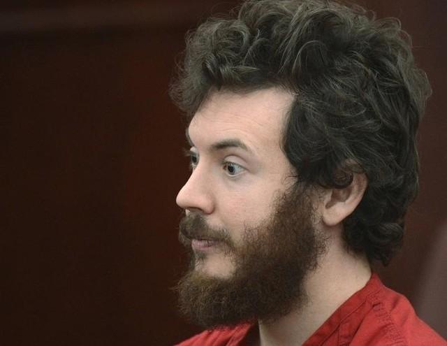 Accused Aurora theater gunman James Holmes listens during his arraignment in Centennial, Colorado, March 12, 2013. (Reuters/R.J. Sangosti/Pool)