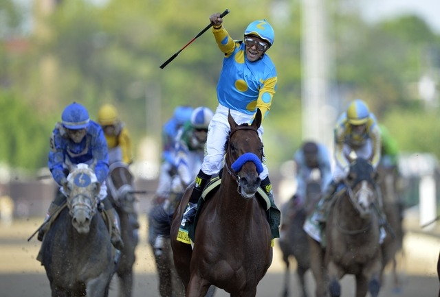 Victor Espinoza aboard American Pharoah, center, celebrates winning the 141st Kentucky Derby at Churchill Downs in Louisville, May 2, 2015. (Jamie Rhodes-USA TODAY Sports)