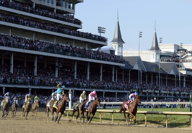 Victor Espinoza aboard American Pharoah, left, celebrates winning the 141st Kentucky Derby at Churchill Downs in Louisville, May 2, 2015. (Jamie Rhodes-USA TODAY Sports)