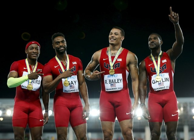 The U.S. 4x100 meters team celebrate with their gold medals after winning the 4x100 meters race at the IAAF World Relays Championships in Nassau, Bahamas May 2, 2015. Jamaica placed second and Jap ...