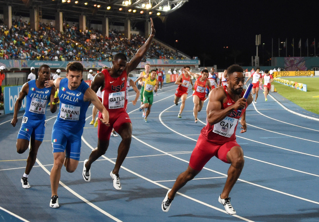 May 2, 2015; Nassau, Bahamas; Tyson Gay takes the handoff from Justin Gatlin on the third leg of the United States 4 x 100m relay that won its heat in 37.87 in the 2015 IAAF World Relays at Thomas ...