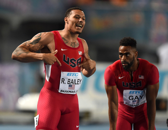 May 2, 2015; Nassau, Bahamas; Ryan Bailey (left) and Tyson Gay react after teaming on the United States 4 x 100m relay that won in 37.28 to tie the American record in the 2015 IAAF World Relays at ...