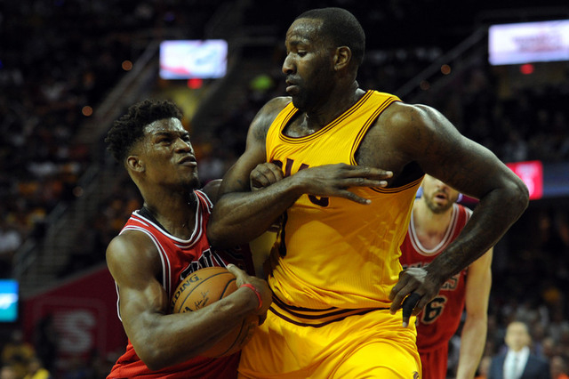 May 6, 2015; Cleveland, OH, USA; Chicago Bulls guard Jimmy Butler (21) tries to drive past Cleveland Cavaliers center Kendrick Perkins (3) during the first quarter in game two of the second round  ...