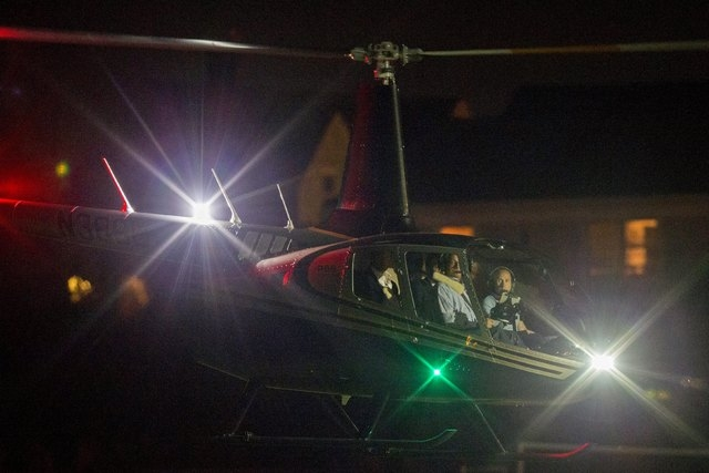 New England Patriots quarterback Tom Brady sits in the back seat of a helicopter as he departs after speaking at Salem State University in Salem, Massachusetts, United States May 7, 2015.  (REUTER ...