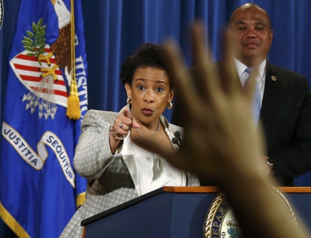 U.S. Attorney General Loretta Lynch takes questions during a news conference, where she announced a federal civil rights investigation into the legality of the Baltimore's police department's use  ...