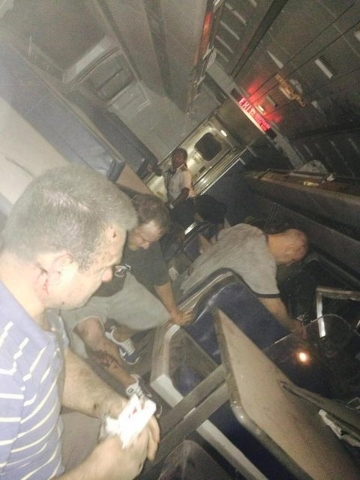 Passengers are seen inside the derailed Amtrak train in Philadelphia May 12, 2015 in a photo provided by former Pennsylvania Congressman Patrick Murphy, who was a passenger on the train. An Amtrak ...