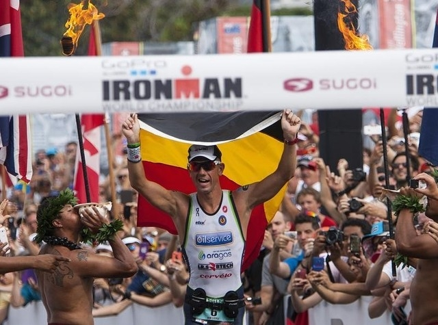 File photo of professional male triathlete Frederik Van Lierde of Belgium celebrates after winning the Ironman World Championship in Kailua-Kona, Hawaii, October 12, 2013. (REUTERS/Hugh Gentry)