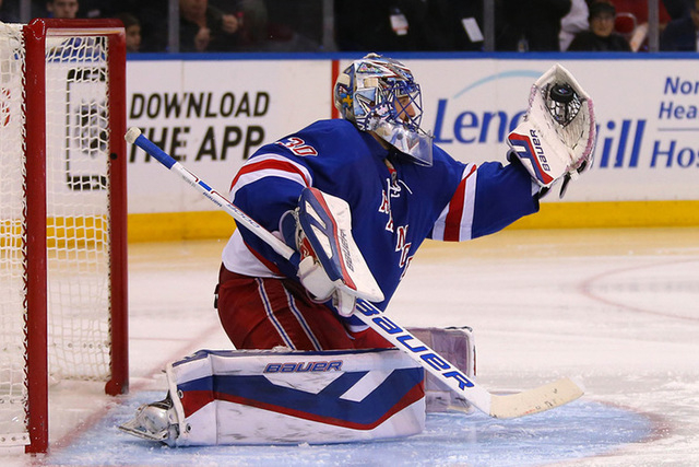 May 13, 2015; New York, NY, USA; New York Rangers goalie Henrik Lundqvist (30) makes a save against the Washington Capitals during the third period in game seven of the second round of the 2015 St ...